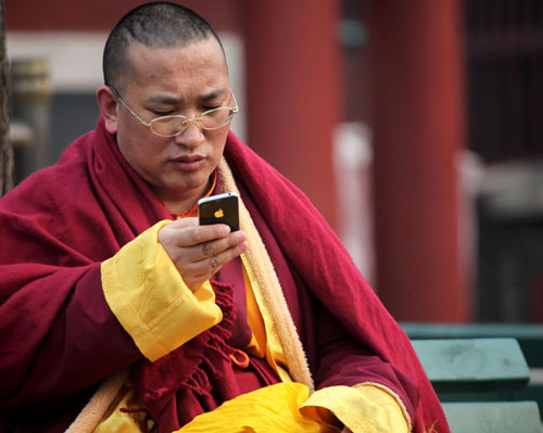 monk-using-iphone-500x399